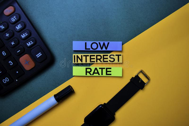 Low Interest Rate text on top view color table background stock photos