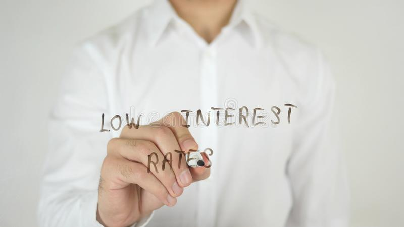 Low Interest Rates, Written on Glass. High quality stock photos