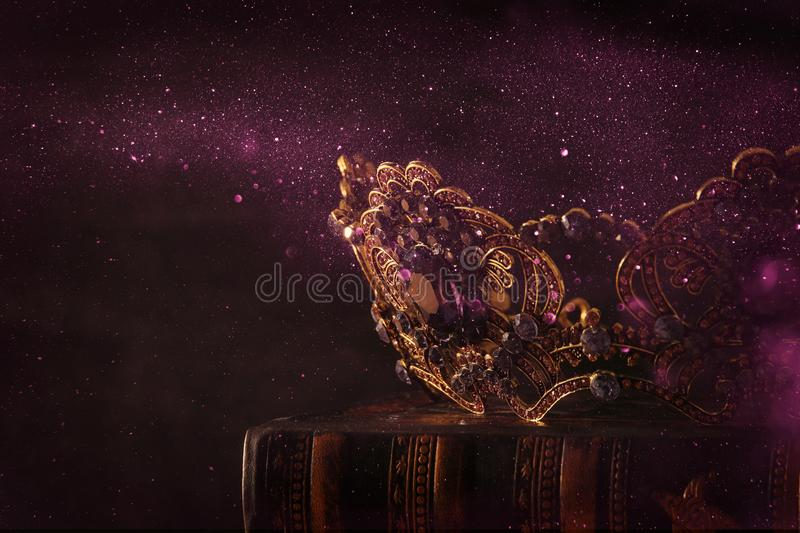 Low key image of beautiful queen/king crown. fantasy medieval period. Selective focus. Low key image of beautiful queen/king crown. fantasy medieval period royalty free stock photo