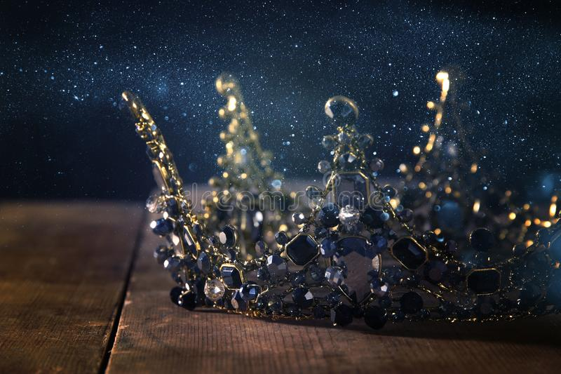 Low key image of beautiful queen/king crown. fantasy medieval period. Selective focus. Low key image of beautiful queen/king crown. fantasy medieval period royalty free stock photography