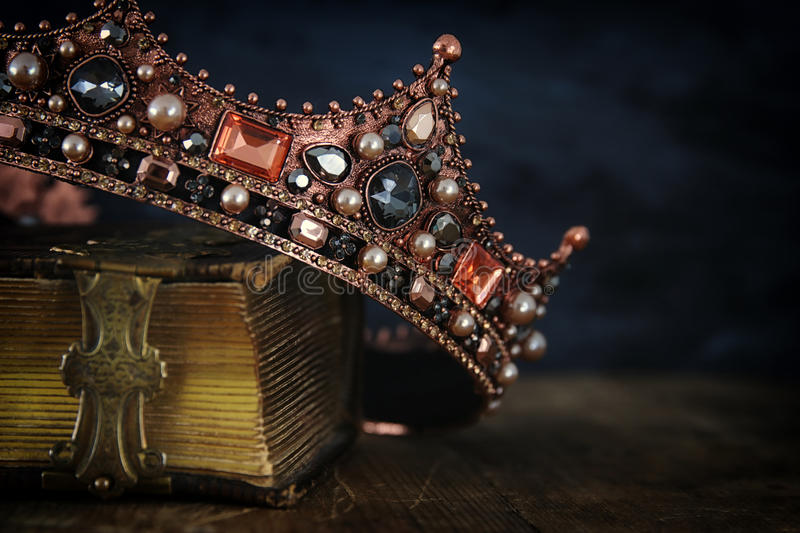 low key image of beautiful queen/king crown on old book royalty free stock photos
