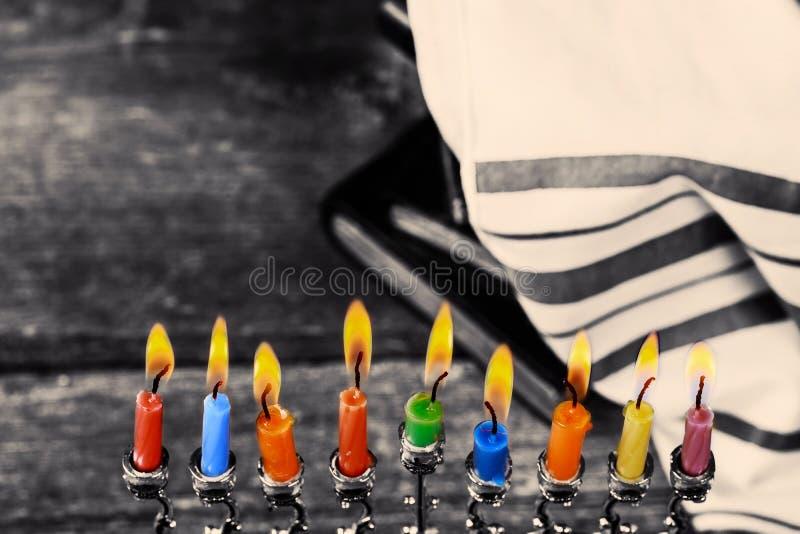 Low key Image of jewish holiday Hanukkah background with menorah traditional candelabra and burning candles royalty free stock image