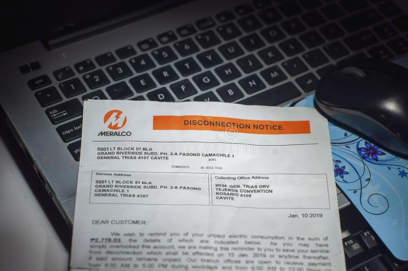 Manila, Philippines - October 5 2019: Dramatic dark shot of MERALCO Disconnection notice from the local Filipino electric company royalty free stock photo