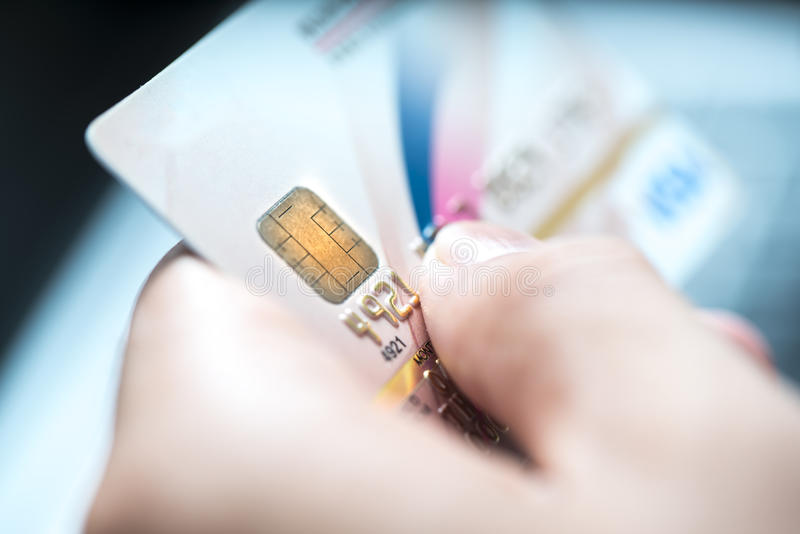 The low-key macro shot with a credit card. stock images