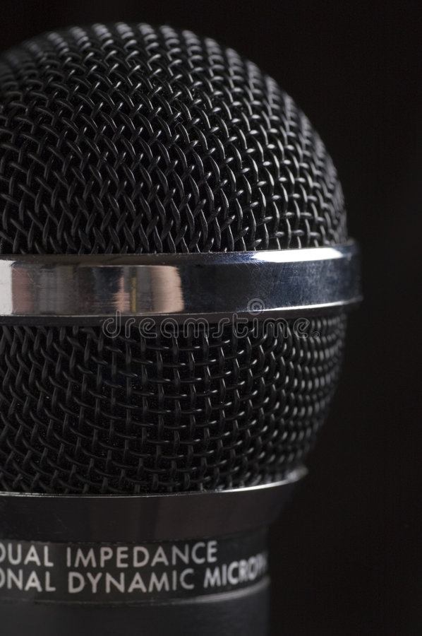 Low key microphone black background royalty free stock photo