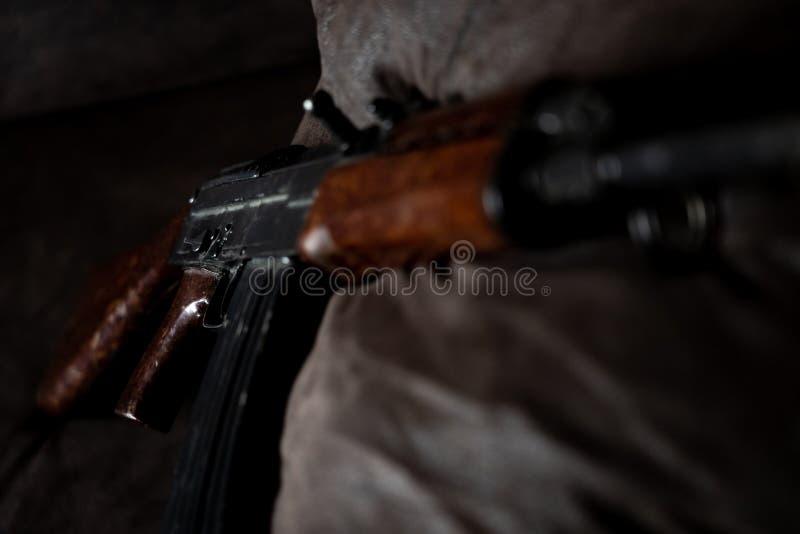 Low key photo of AK-47 Kalashnikov rifle. Dark themed automatic rifle from Russia/Soviet union stock images