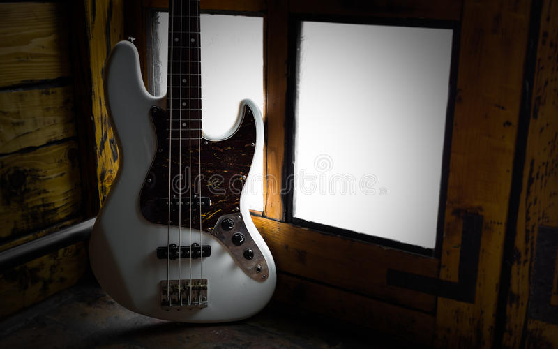 Low key photo with old vintage bass. Guitar royalty free stock photography