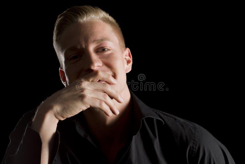 Download Low Key Portrait Of Joyful Man Looking Straight. Stock Photo - Image: 29669652