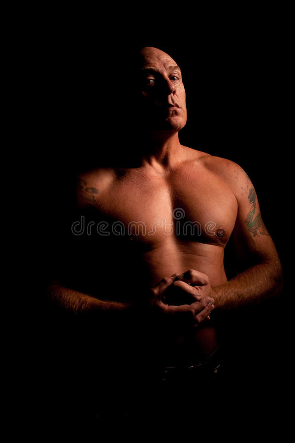 Download Low Key Portrait Of Muscular Middle Aged Man Stock Photo - Image of male, shaved: 28500910
