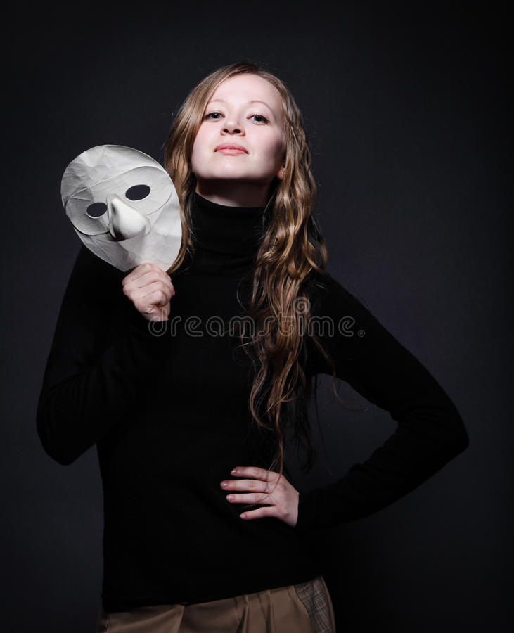 Free Low Key Portrait Of A Beautiful Woman Holding Mask Stock Photo - 25144660