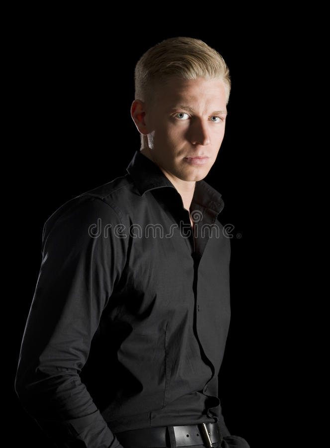Download Low Key Portrait Of Young Alluring Man Looking Straight. Stock Image - Image: 29669703