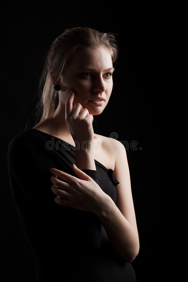 Low key portrait of a young woman royalty free stock images