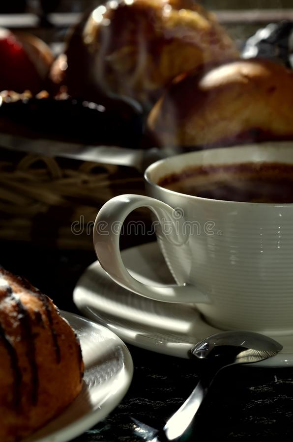 Low key shot of a cup of coffee royalty free stock images