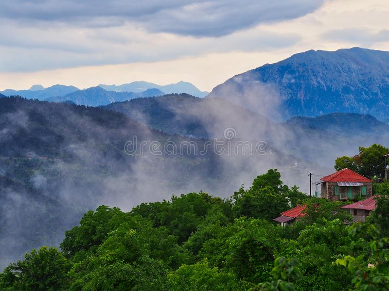 Low Level Clouds in Greek Mountain Village, Greece royalty free stock photography