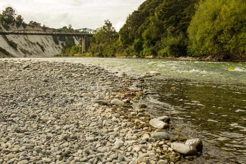Low level shot of a fast flowing shallow river,  Rangitikei River in New Zealand. Nobody in the image royalty free stock photography
