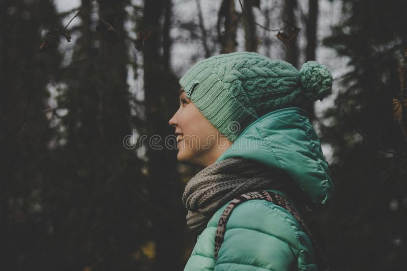 Low Light Photo of Person Wearing Green Jacket and Hat royalty free stock photos