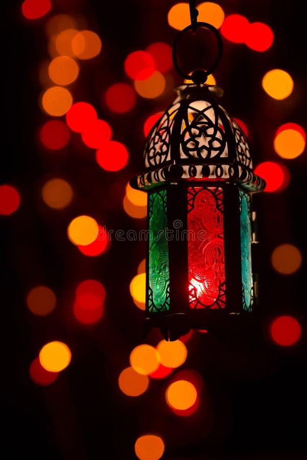 Low light studio set up shot of lighted lantern - showing ramadan kareem or eid mubarak celebration conceptual royalty free stock photography