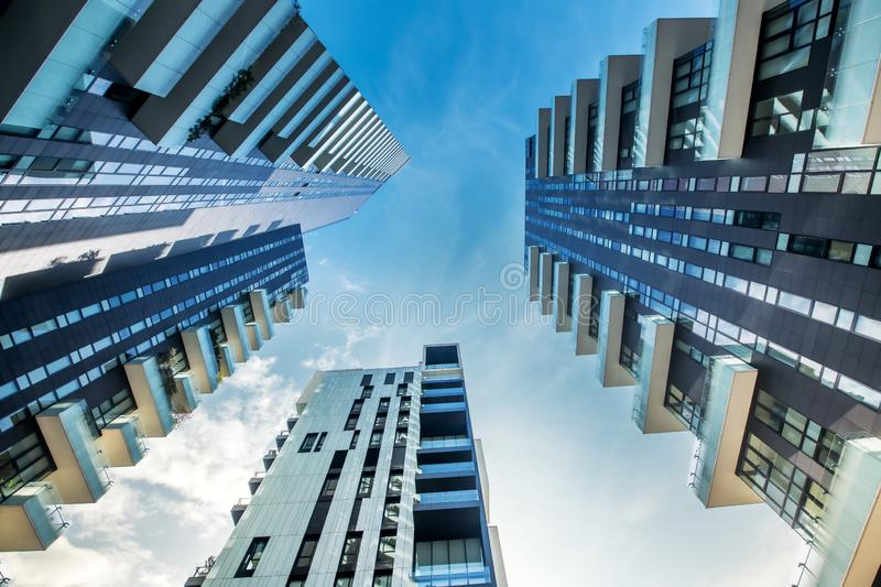 Low perspective of modern Milan apartment blocks. Low perspective view of modern Milan apartment blocks with large balconies looking up from below as they stock image