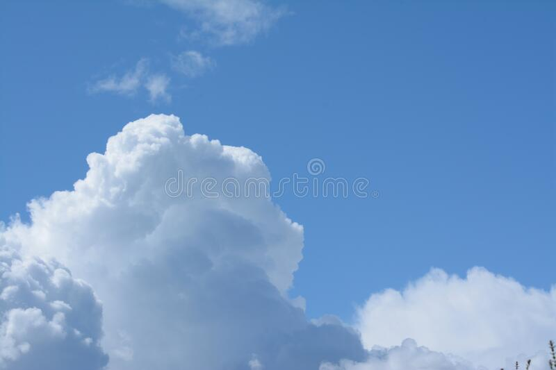 Unpoluted sky with cumulus clouds stock image