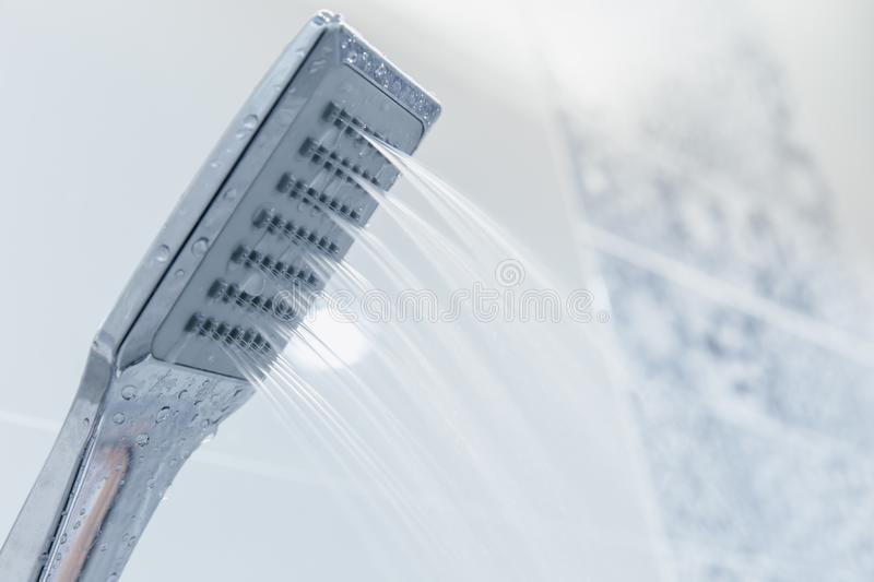 Low pressure problem shower head in bathroom. Clean new modern design royalty free stock image