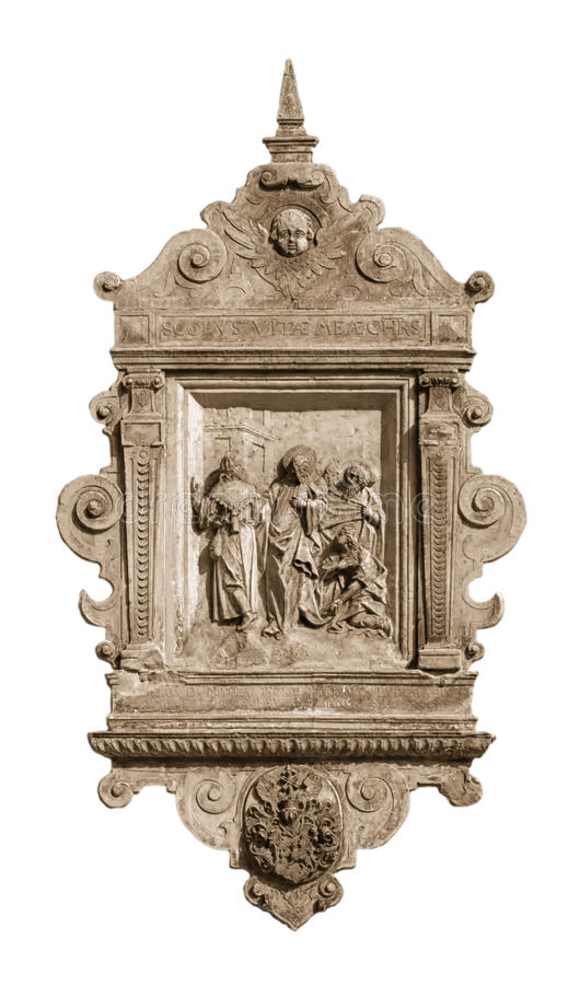 Low relief on the wall of the house in Riga. Low relief with religious scenes on the wall of a house in the historic center of Riga royalty free stock photo