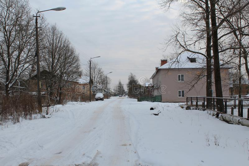 Low-rise buildings in Russia. Unclean road. A lot of snow. royalty free stock photos