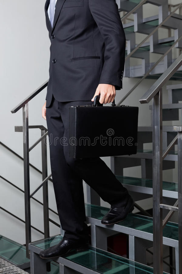 Low Section Of Businessman Descending Stairs stock photography