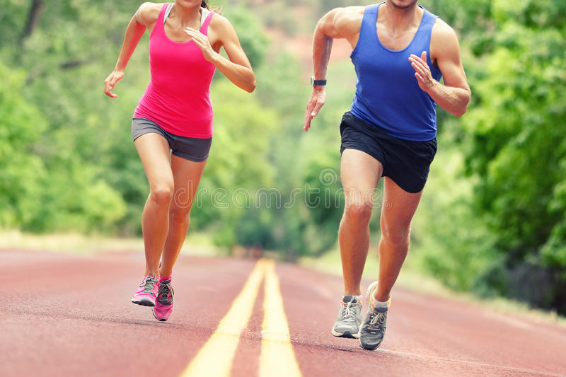 Low Section Of Determined Couple Running On Road stock images