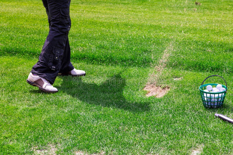 Low section of golf player ready to hit the ball royalty free stock photo