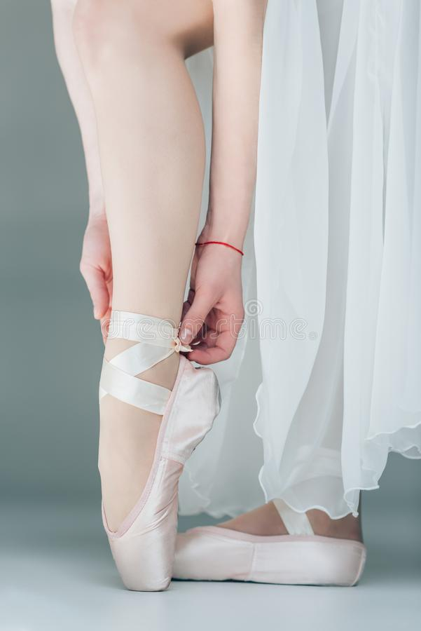 Low section view of feet of dancer. In ballet shoes royalty free stock photography