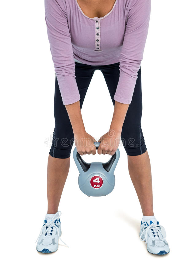 Low section of woman exercising with kettlebell stock photo