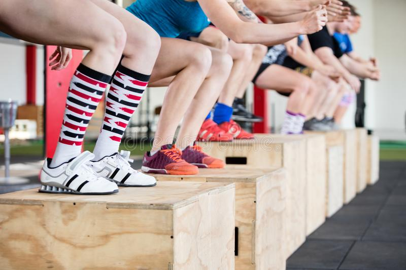 Low Section Of Women Performing Box Jumps With Friends stock images