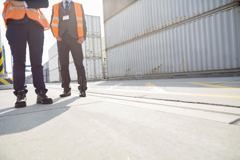 Low section of workers standing in shipping yard stock photo