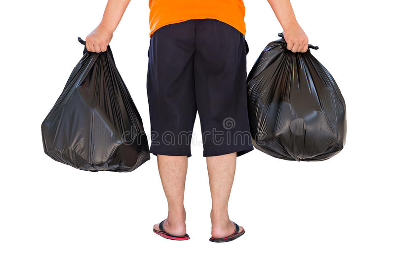 Low section of young man carrying garbage bags isolated on white royalty free stock photography