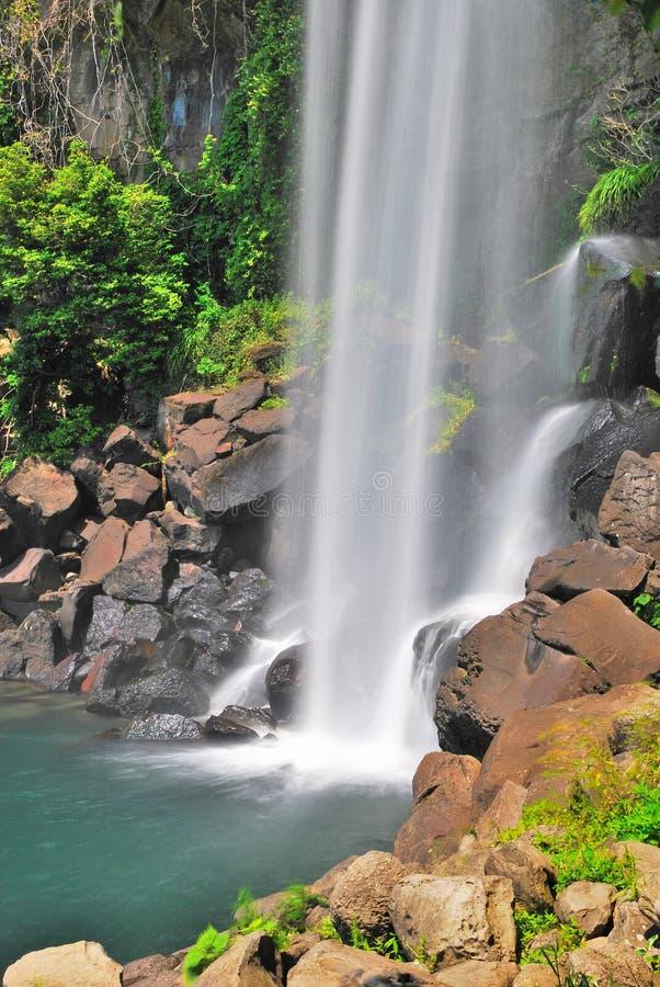 Low shot of majestic waterfall. Splashing onto rocks royalty free stock photos