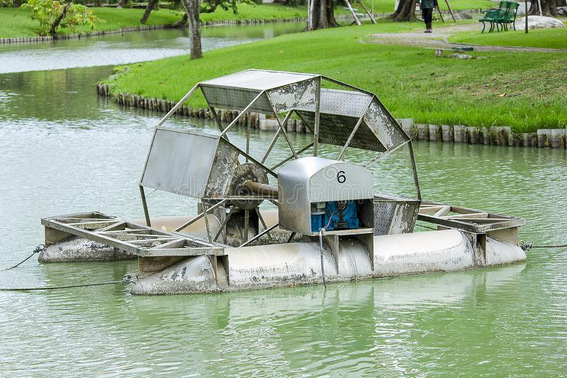 Chaipattana Low Speed Surface Aerator is in the water. Low speed surface Aerator is a water turbine for wastewater treatment by aerating method royalty free stock photo