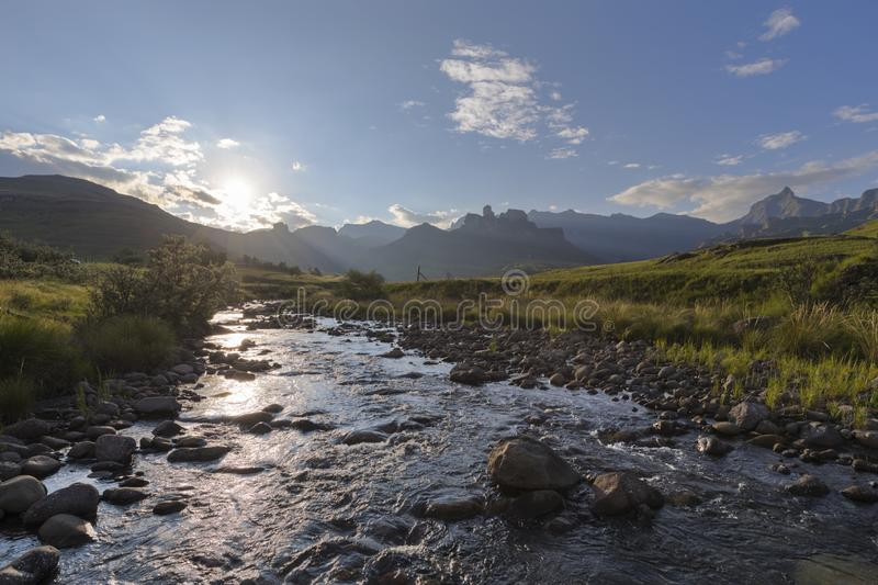 Low sun reflect on water in river. Drakensberg South Africa royalty free stock photos