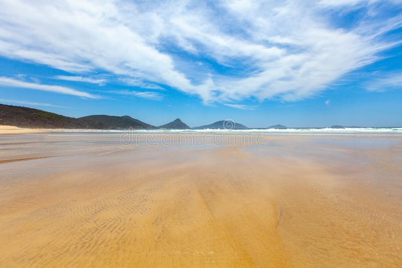 Low tide on Fingal Bay. royalty free stock images