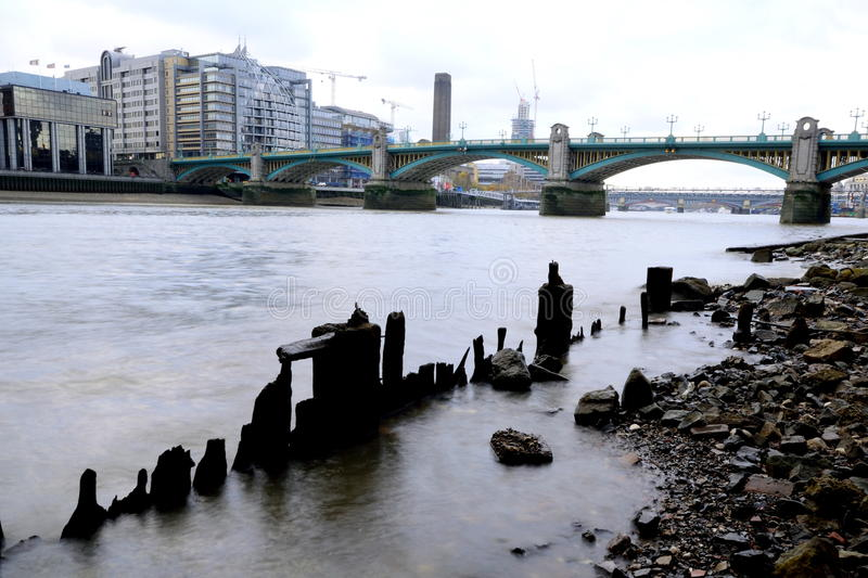 Low tide. River Thames at low tide in London stock image