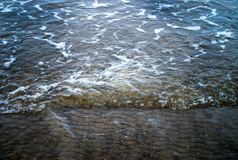 Low Tide Sea Foam Ripples background royalty free stock photography
