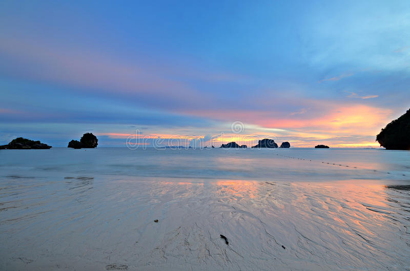 Low tide at sunset. Low tide with a vibrant colored sunset in the majestic scenery of Railey Bay, Krabi, Southern Thailand. Blurred motion, very long exposure stock photos