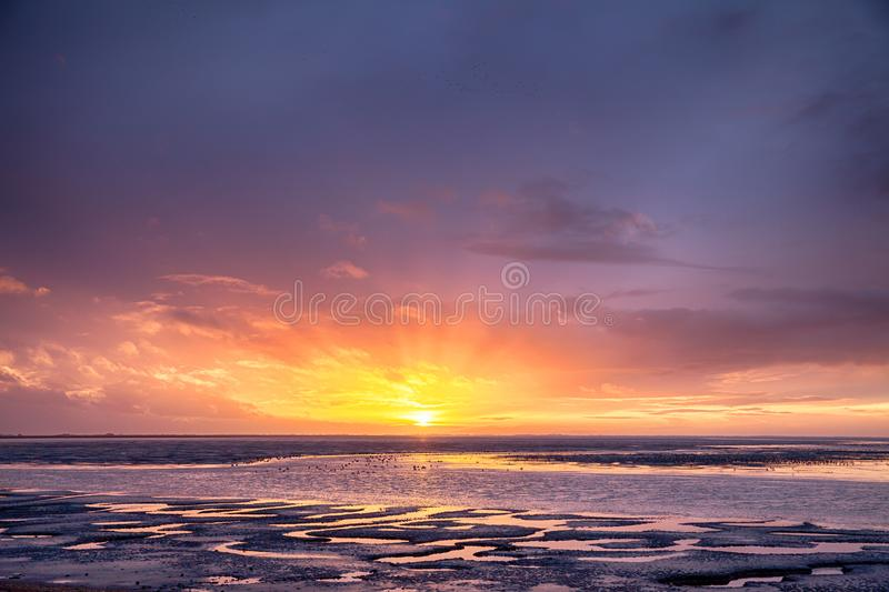 Low tide sunset on Norfolk beach royalty free stock photos
