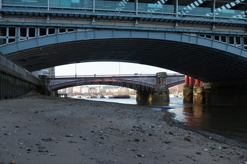 Low Tide on the Thames. View up river on the Thames from the South Bank beach at low tide royalty free stock photo