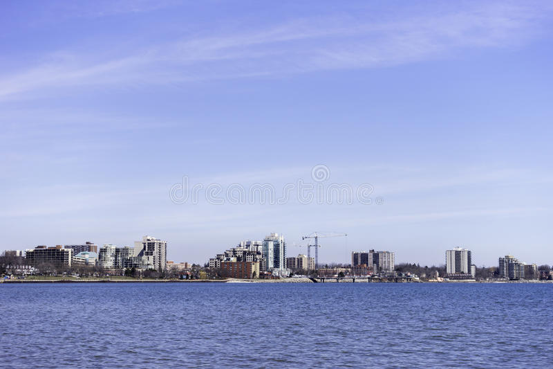 Low urban skyline across a blue water, large sky, background spa. Ce for text stock images