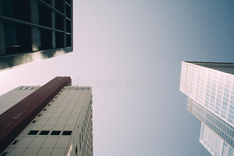 Low View of White High Rise Building stock photography