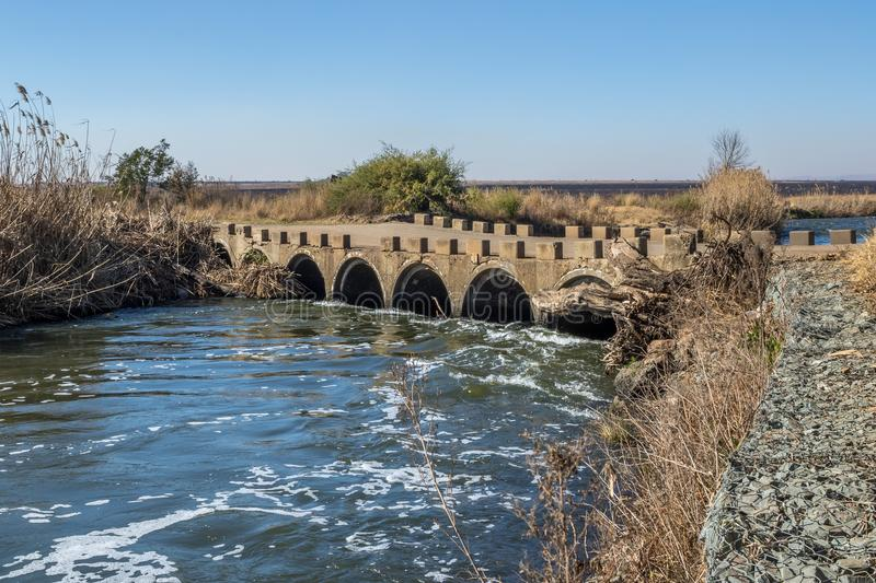 Low water bridge with a gabion retaining wall royalty free stock photo