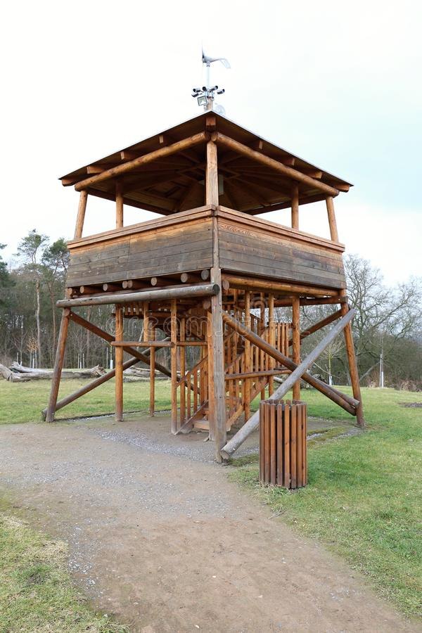 Low wooden outlook tower with stairways and cameras on top. Low square wooden outlook tower with stairways and cameras on top royalty free stock images