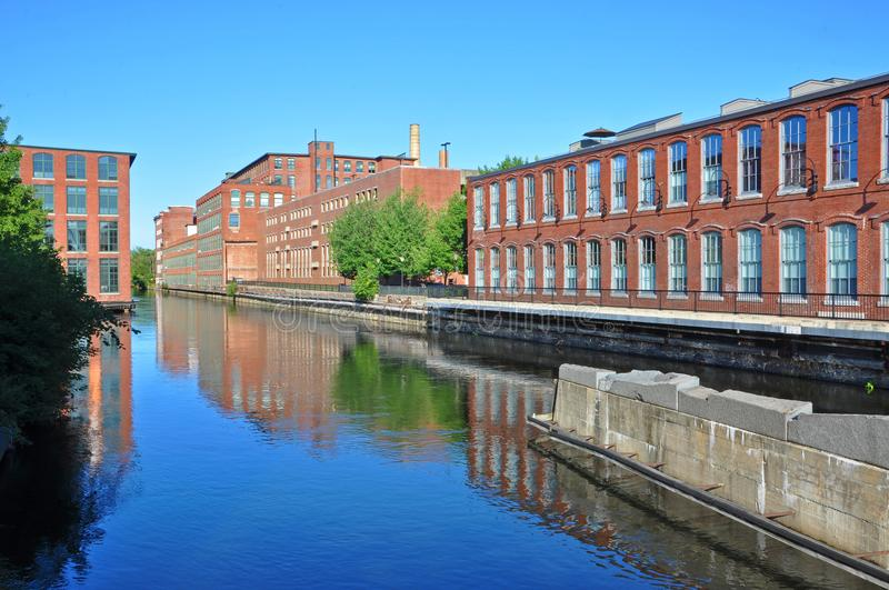 Lowell Canal, Massachusetts, USA. Pawtucket Canal and historic mill buildings in Lowell National Historic Park in downtown Lowell, Massachusetts, USA stock photography