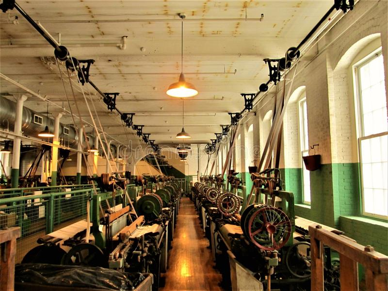 Lowell National Historic Park. During the Industrial Revolution, girls and women worked in these rooms on The Mills royalty free stock photo