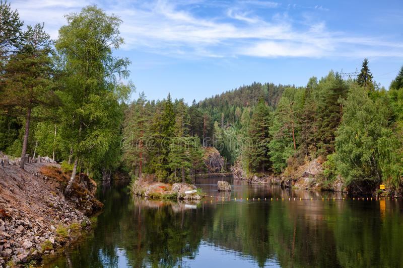Lower canal of Vrangfoss lock at Telemark Canal Telemark County. Lower canal, an entrance route to the Vrangfoss lock at Telemark Canal, Telemark County, Norway stock photo